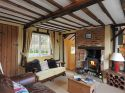 Cosy sitting room with lots of character and log burner