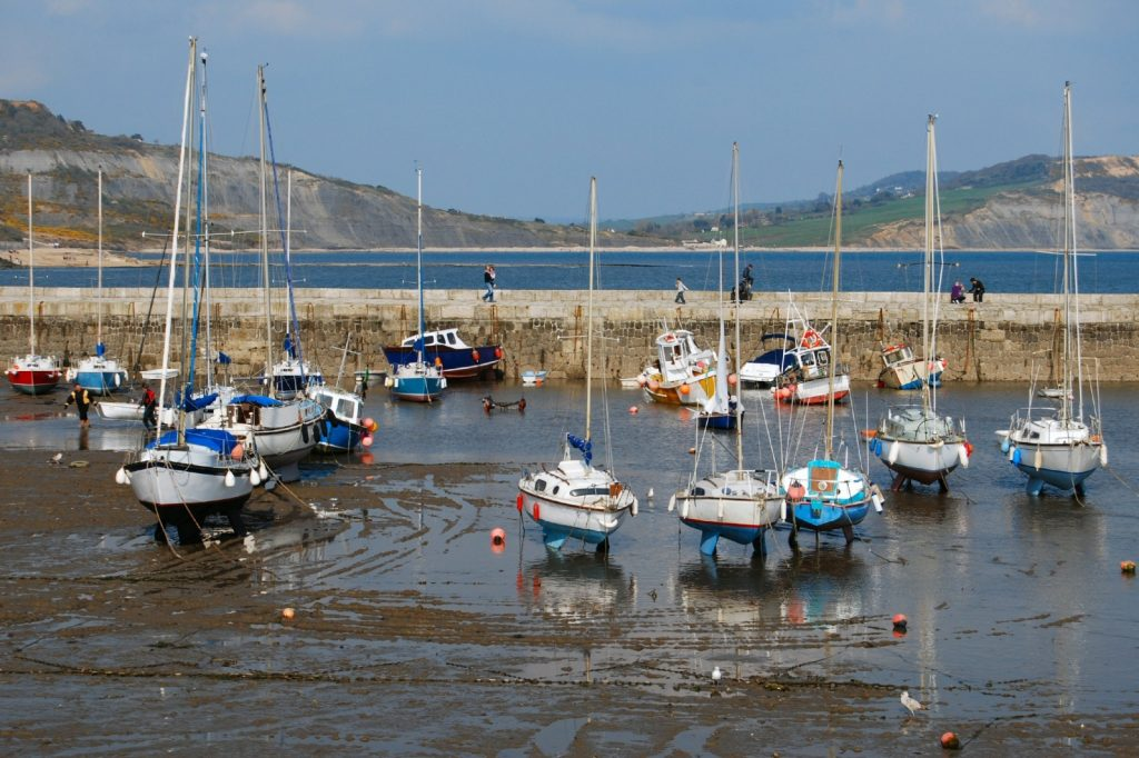 Boats on the sand with tide out in harbour