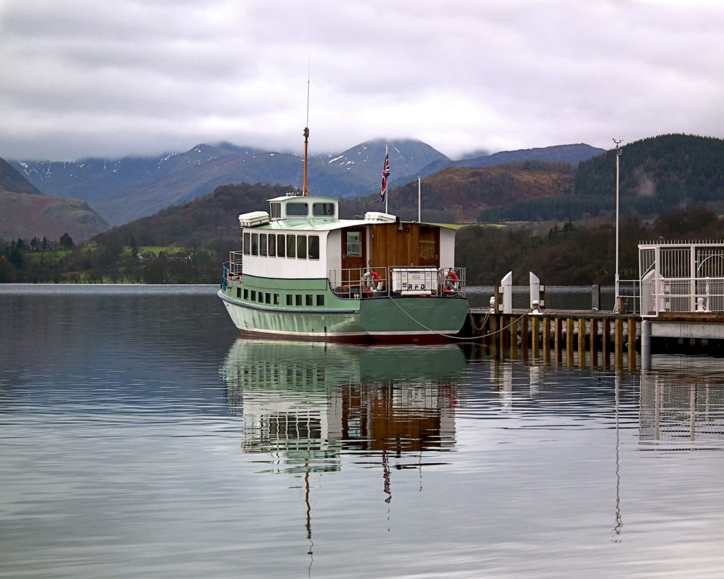 Ullswater cruiser boat moored up at the jetty on the lake