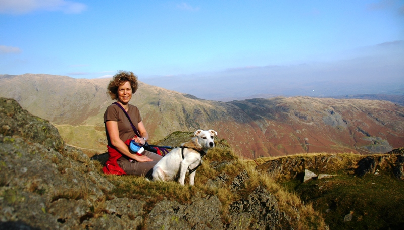 Lady with her Jack Russell dog looking over the peaks