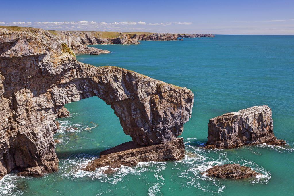 Impressive arch rock formation in the sea