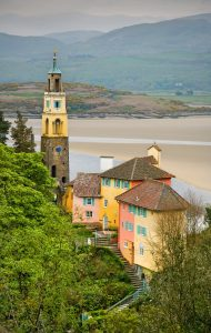 Colourful houses of Portmeirion overlooking the sand and water
