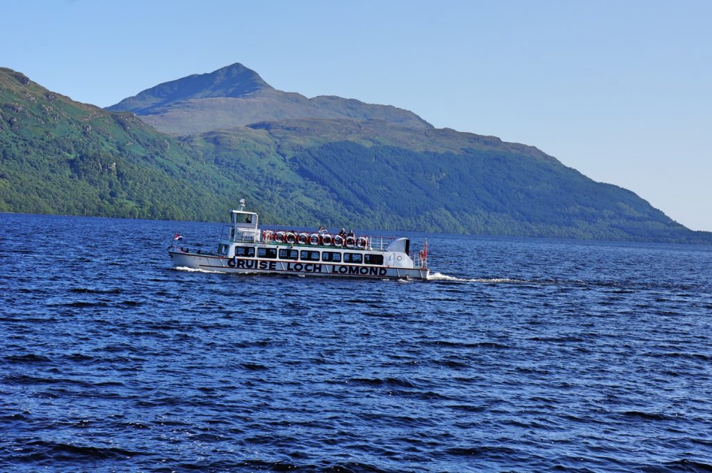 The Loch Lomond cruise ship on the water with mountains as a backdrop