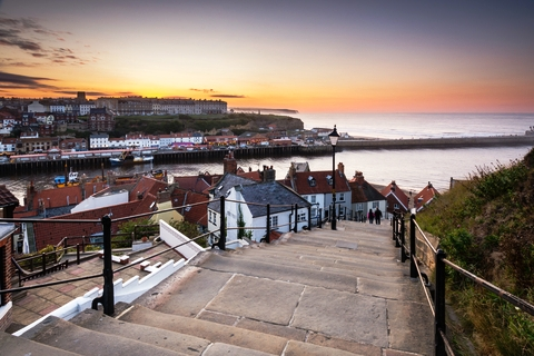 Steps leading to Whitby harbour with sea beyond