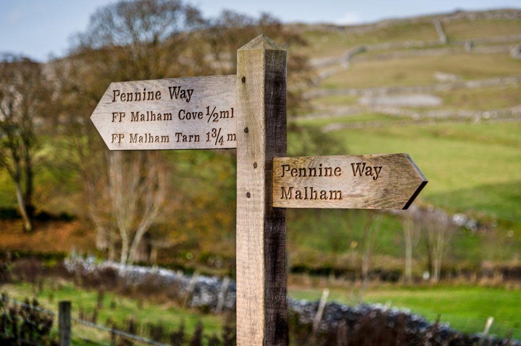 Sign post stating Pennine Way, Malham