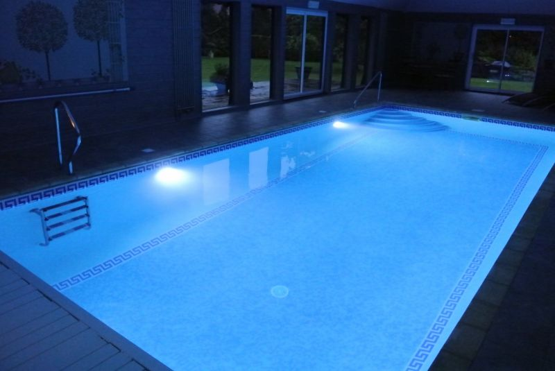 Swimming pool by night with underwater lighting