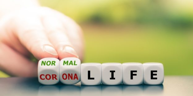 Dices saying 'normal life' 'corona life'